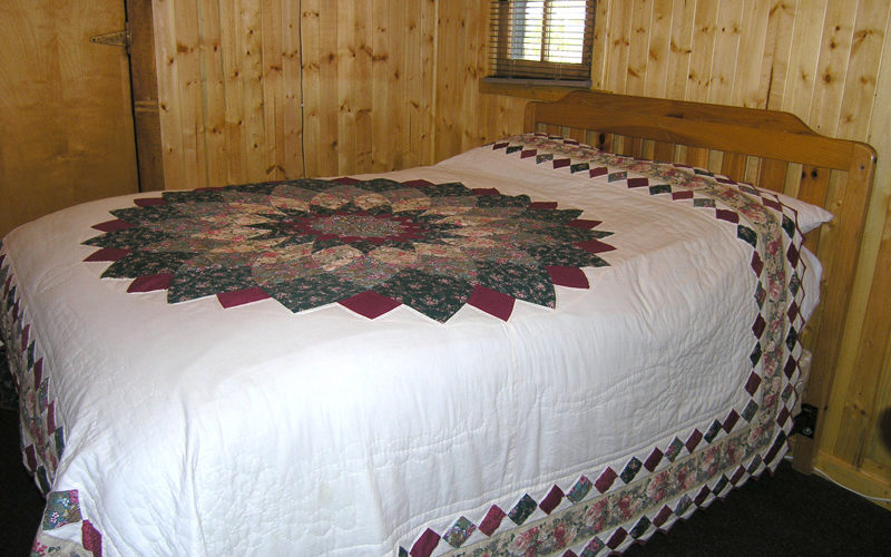 Cabin 4 - Vacation Cabin Rental Bed